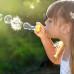 Мыльные пузыри и девочка